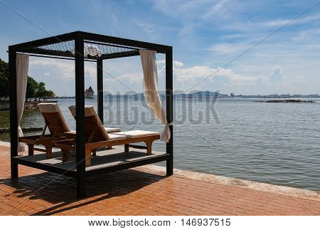 Beach lounge - Sundeck on Sea view for vacation and summer . Seaside spa bed in Pattaya Thailand on holidays