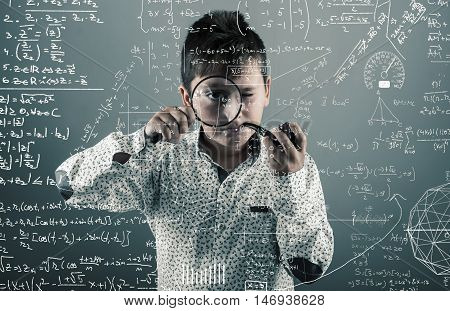Kid with a pipe look through magnifying glasses to mathematical formulas and problems.