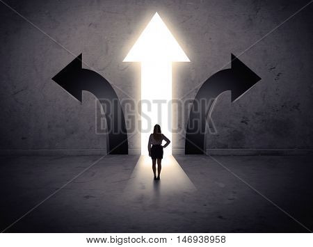 A businesswoman in doubt, having to choose between three different choices indicated by arrows pointing in opposite direction concept