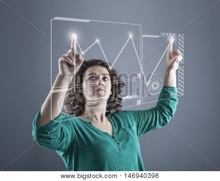 Teenager girl working wth touch screen technology