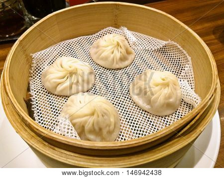 Chinese Dumpling in bamboo steamer, chinese cuisine
