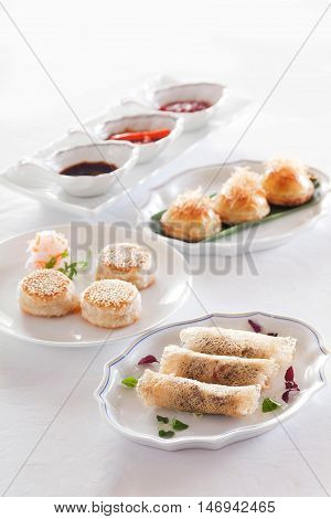 Chinese Dim Sum with Sauce on a white background
