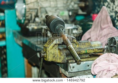 Mechanical automotive fixing engineering industry concept. Car joints in workshop. Vehicle elements disassembled to be repaired.