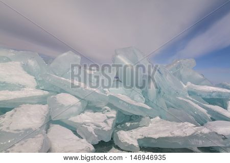 Winter Baikal lake landscape with hummock on blue sky