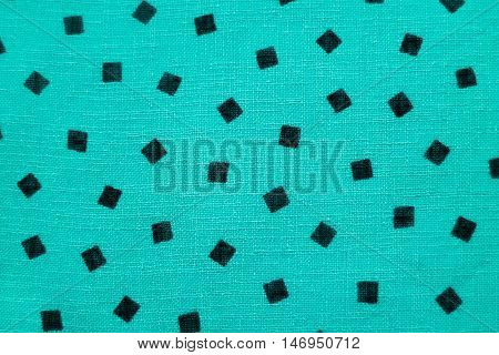Cyan faric with small balck square printed. Green textile background. Turquoise canvas cloth texture.