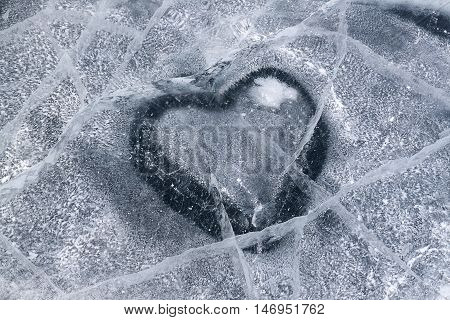 Heart shape on ice winter Baikal lake texture