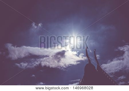 Silhouette Photo Of Thai Roof With Sun Beam Over Rooftop With Sky And Cloud