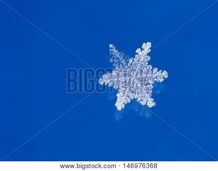 Super macro shot of natural glitter snow flakes