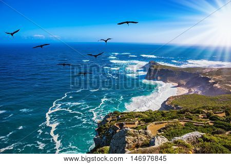 The powerful ocean surf in the Atlantic Ocean. Cape of Good Hope - the most south-westerly point of Africa. Sunset
