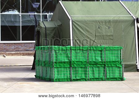 Internal heat insulation for pneumatic tents in block packages of green color near tent