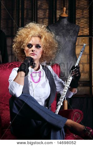 Beautiful and sexy Flautist posing with her instrument