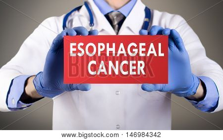 Doctor's hands in blue gloves shows the word esophageal cancer. Medical concept.
