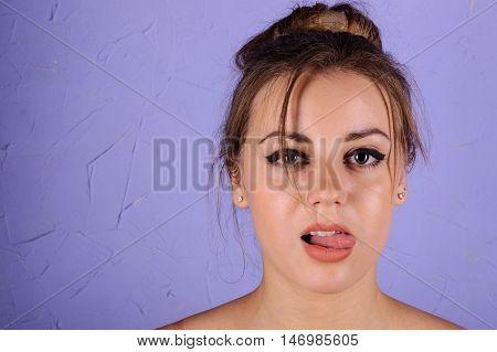 Portrait Of Beautiful Girl On A Blue Background, Showing Tongue