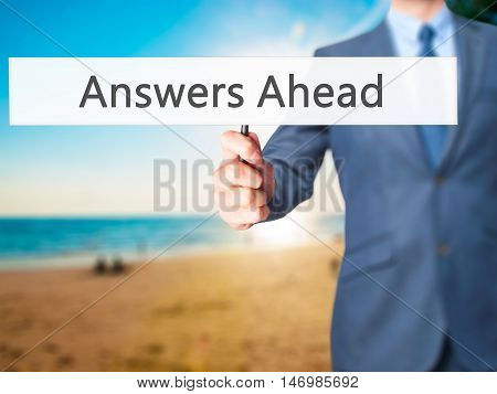 Answers Ahead - Businessman Hand Holding Sign
