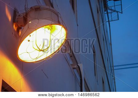 Lighting of warm lamp in the outside of building with twilight time on offshore platform.