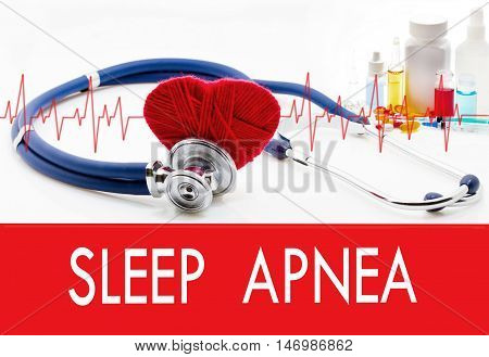 Medical concept sleep apnea. Stethoscope and red heart on a white background