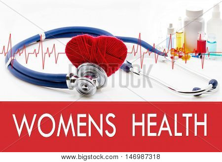Medical concept womens health. Stethoscope and red heart on a white background