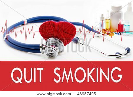 Medical concept quit smoking. Stethoscope and red heart on a white background