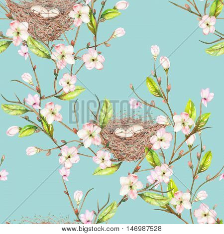 Seamless pattern of the watercolor bird nests on the tree branches with spring flowers, hand drawn on a blue background