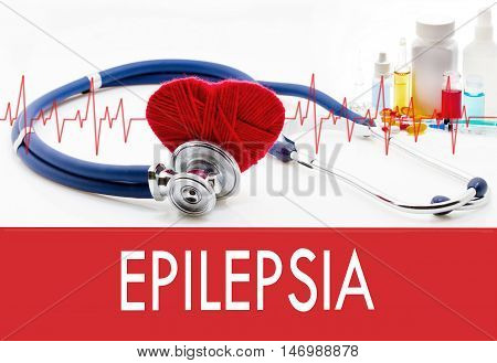 Medical concept epilepsia. Stethoscope and red heart on a white background