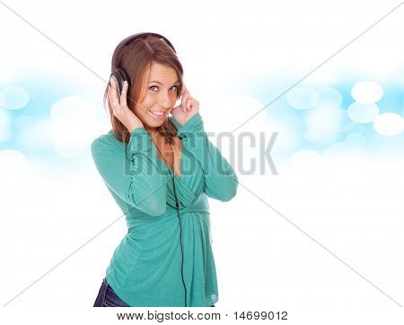 Close-up of pretty girl in headphones listening to music with pleasure