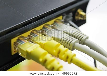 Network cables connected to an Fast/Giga ethernet ports.