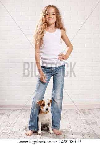 Child with dog. Girl in jeans