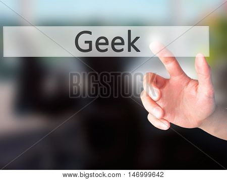 Geek - Hand Pressing A Button On Blurred Background Concept On Visual Screen.
