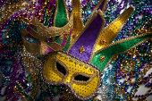 A group of mardi gras beads and mask with copy space