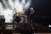 DUBLIN - JUNE 12 : Rick Savage (R) and Rick Allen (L)of Def Leppard rock group on stage during their