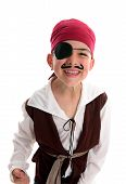 stock photo of plunder  - A happy young boy wearing a pirate costume - JPG