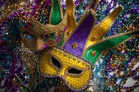 picture of mardi gras mask  - A group of mardi gras beads and mask with copy space - JPG