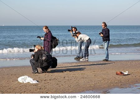 Five Photographers On A Beach