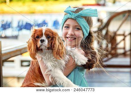 Happy Child With Dog Portrait