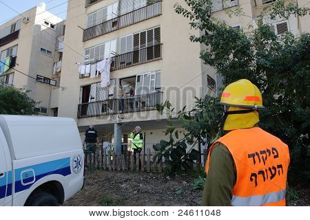 ASHKELON - JANUARY 10: An israel military rescue team member in front of apartment buiding that was hit by palestinian missile launched from Gaza on January 10, 2009 in Ahskelon, Israel.