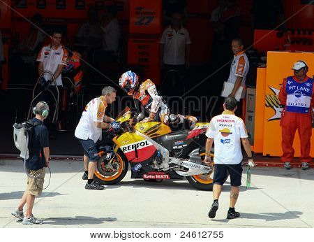 SEPANG, MALAYSIA - OCTOBER 21: MotoGP rider Casey Stoner returns to the garage after a free practice ride on Day 1 of the Malaysian Motorcycle GP 2011 on October 21, 2011 at Sepang, Malaysia.