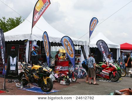 SEPANG - OCT 21: Motorcycle racing fans view the bikes and accessories on show at the Malaysian Motorcycle GP 2011 on Oct 21, 2011 at Sepang, Malaysia. The event attracted over 100,000 fans this year.