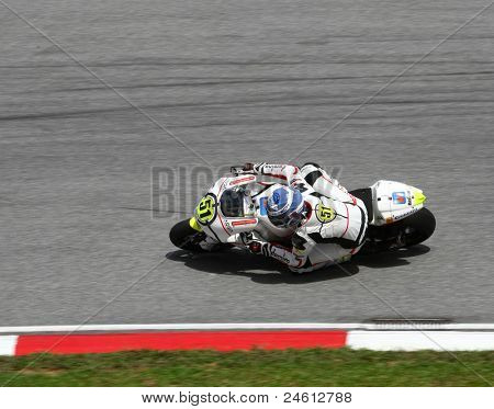 SEPANG, MALAYSIA - OCTOBER 23: Moto2 rider Michele Pirro competes on race day of the Shell Advance Malaysian Motorcycle Grand Prix 2011 on October 23, 2011 at Sepang International Circuit, Malaysia.