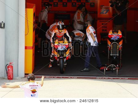 SEPANG, MALAYSIA - OCTOBER 21: MotoGP rider Casey Stoner prepares to leave the garage for a free practice ride on Day 1 of the Malaysian Motorcycle GP 2011 on October 21, 2011 at Sepang, Malaysia.