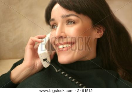 a beautiful woman speak at telephone
