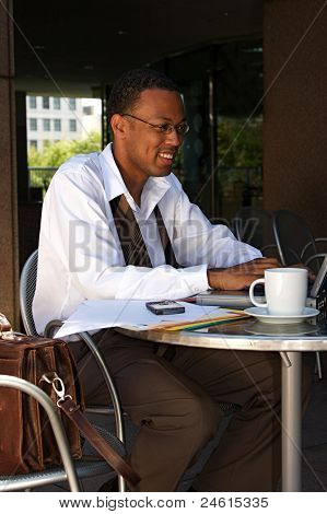 Businessman At A Cafe