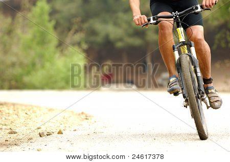 Man rides a bike.