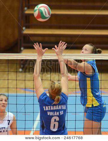 KAPOSVAR, HUNGARY - OCTOBER 2: Alexandra Csaszar (R) in action at a Hungarian NB I. League volleyball game Kaposvar (yellow number) vs Tatabanya (white number), October 2, 2011 in Kaposvar, Hungary.
