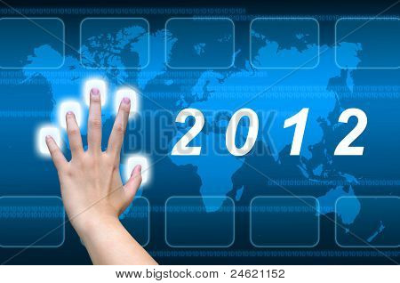 hand pushing 2012 button on a touch screen interface