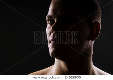 Dark portrait of strong athletic man