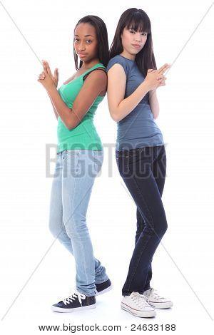 Teenage Girls Playful Secret Agent Fun Gun Pose