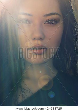 Summer sun beam photo of beautiful young Asian woman