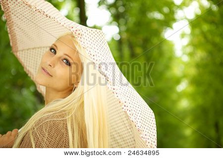 Dreamy Young Woman In Park