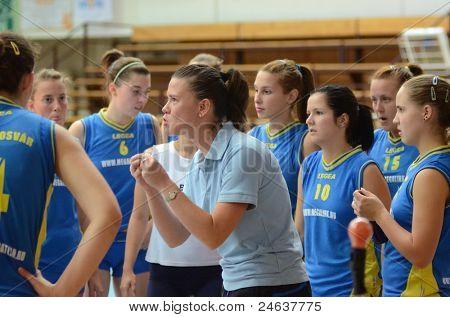 KAPOSVAR, HUNGARY - OCTOBER 2: Kaposvar players listening to trainer at a Hungarian NB I. volleyball game Kaposvar (yellow number) vs Tatabanya (white number), October 2, 2011 in Kaposvar, Hungary.