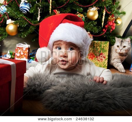 Little boy in Santa Claus hat.